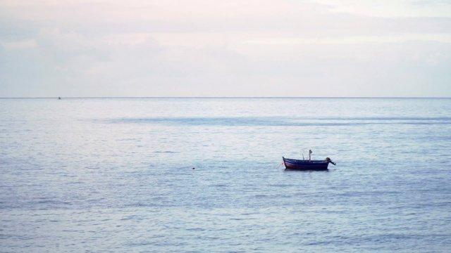 Lonely Boat At Sea thumbnail