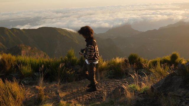 Traveler Photographer Takes Photos of Mountains thumbnail