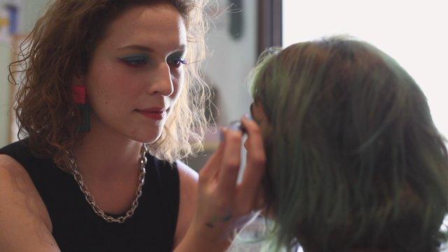 Colorful Makeup Artist Applies Makeup thumbnail