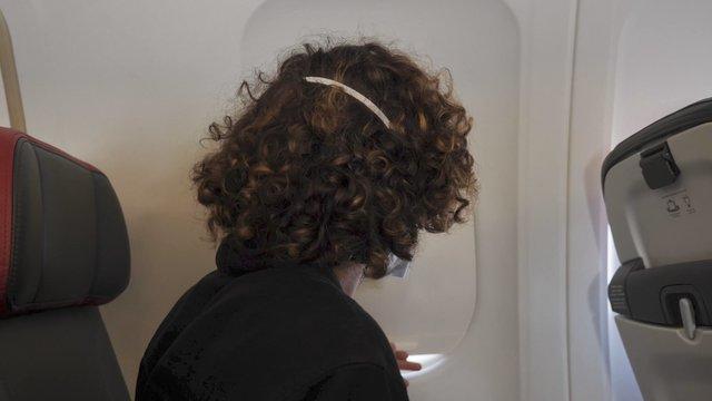 Close-up Shot of Guy Opens Airplane Porthole thumbnail