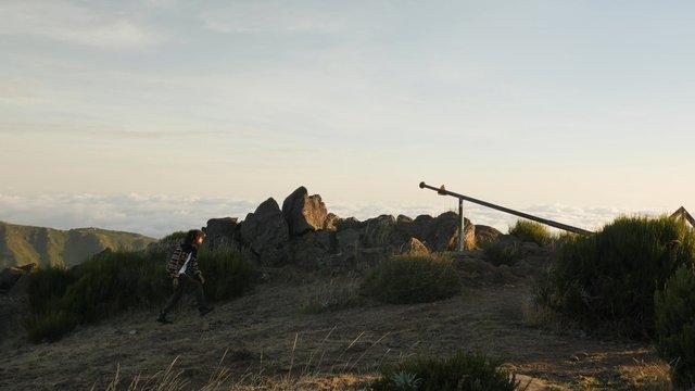 A Hiker Climbs on the Stones thumbnail