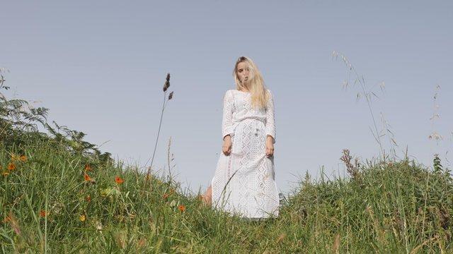 Blonde Girl Posing in a Field  thumbnail