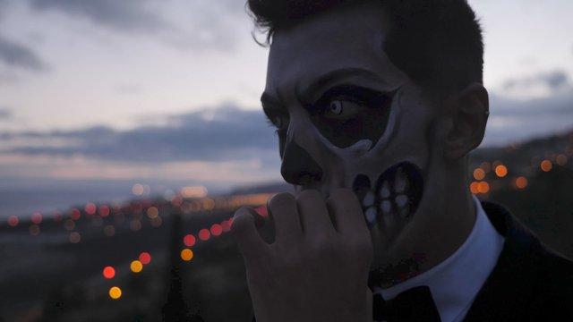 Close up a Mysterious Man Smokes a Cigarette thumbnail