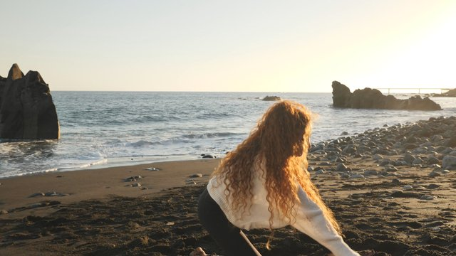 Woman Dancing on the Seashore thumbnail