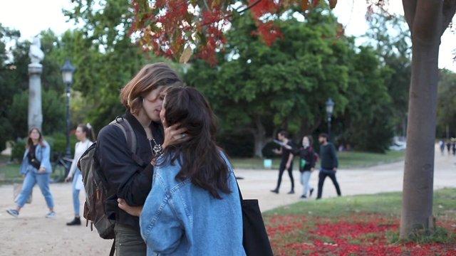 Lesbian Couple Kissing in the Park thumbnail