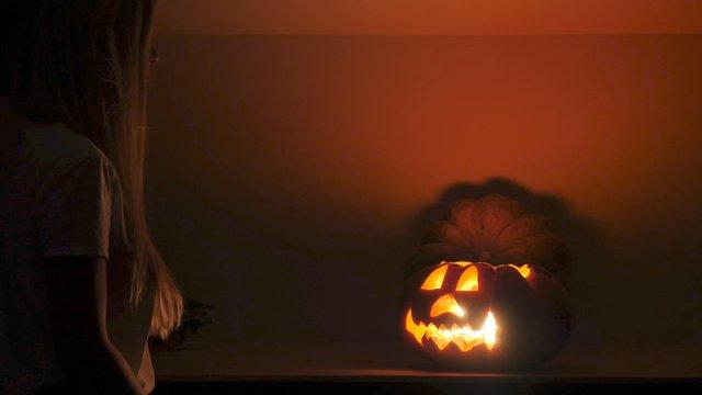 Girl with glowing jack o' lantern thumbnail