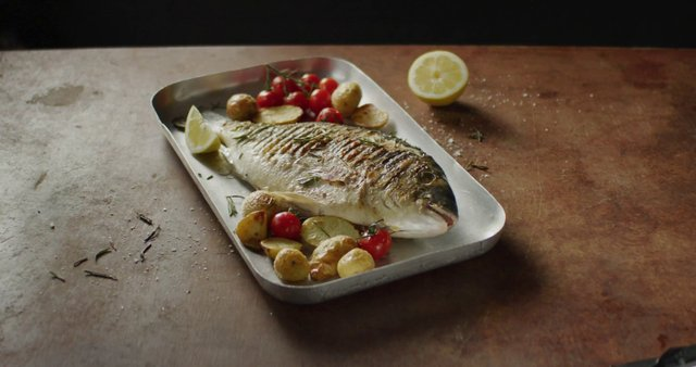 Squeezing Lemon on Baked Fish thumbnail