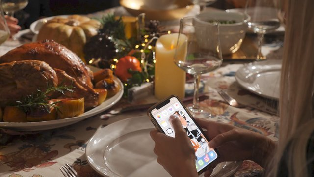 Girl Makes Photos of a Festive Table thumbnail