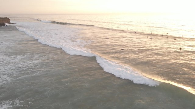 Surfers Catching Waves thumbnail