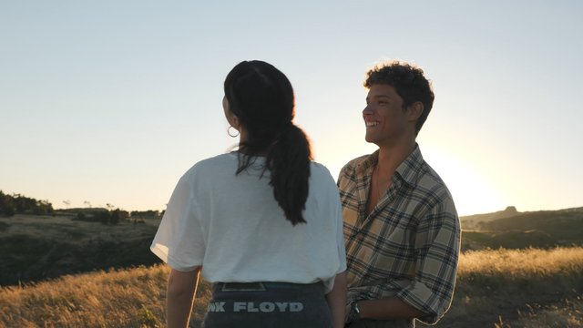 Medium Shot of a Smiling Couple in the Field thumbnail