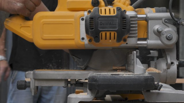 A Table Saw Cuts Wood on a Construction Site thumbnail