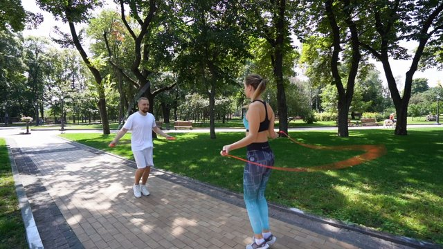 Couple Jumping Rope in Park thumbnail