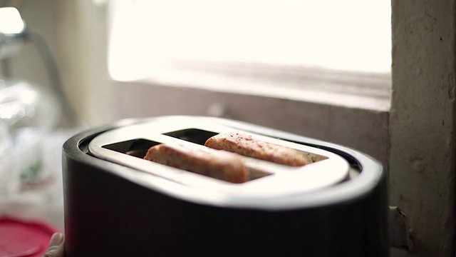 Cooked Toast Jumping Out Of Toaster  thumbnail
