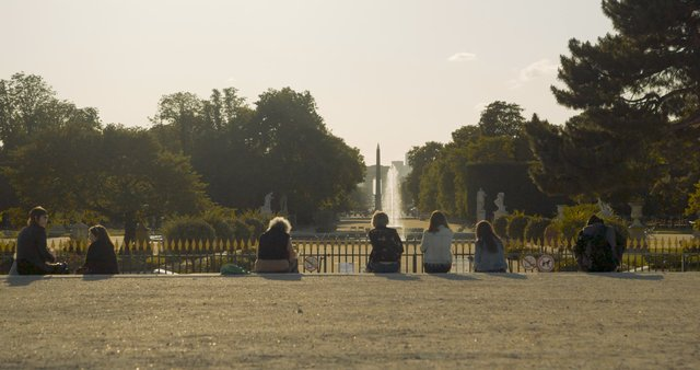 People Talking near Louvre Fountain in Paris  thumbnail