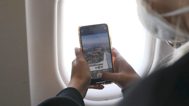 Girl Takes a Photo From an Airplane thumbnail