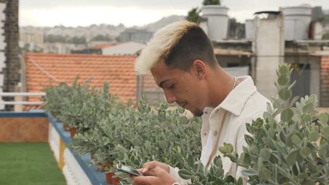 Young Man on a Rooftop Terrace thumbnail