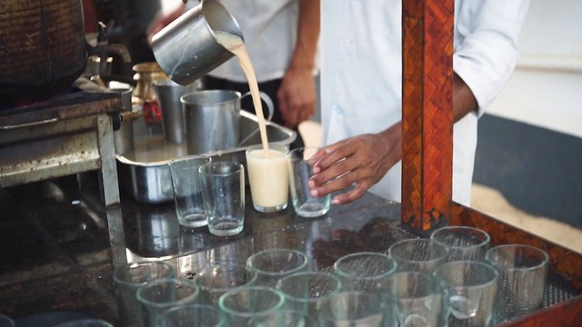 Pouring Chai Tea Into Cups In Kerala India thumbnail