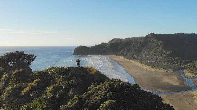 Romantic Couple On Lion Rock Near Piha Ocean, NZ thumbnail