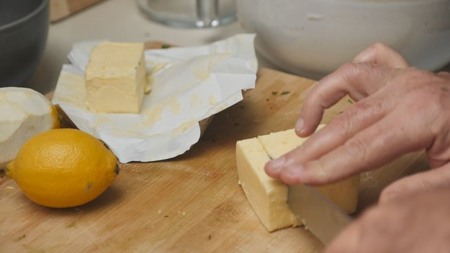 Cutting of a Butter on a Cutting Board thumbnail