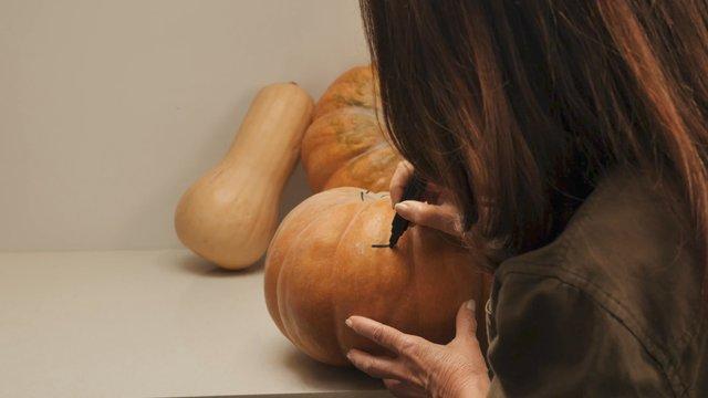 Close up Painting on a Pumpkin thumbnail