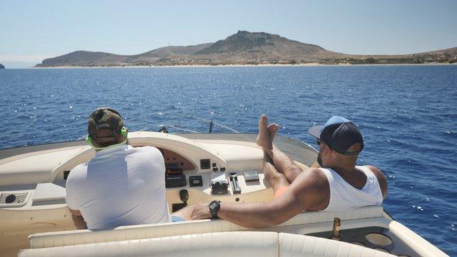 Two Men Driving a Boat thumbnail