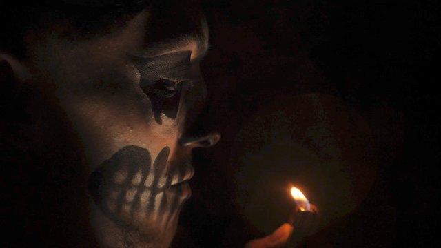 A Lighter Burns Near a Man's Face thumbnail