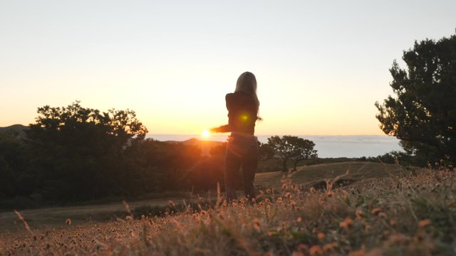 Smiling Girl Rejoices at Sunset Background thumbnail