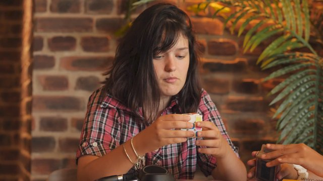 Girl Trying to Solve a Rubik's Cube thumbnail
