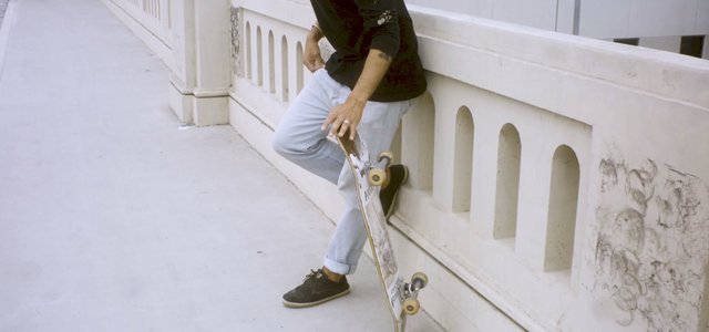 Skater Walking in Downtown Los Angeles thumbnail