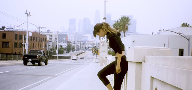 Girl Stands on the Bridge in Downtown Los Angeles thumbnail