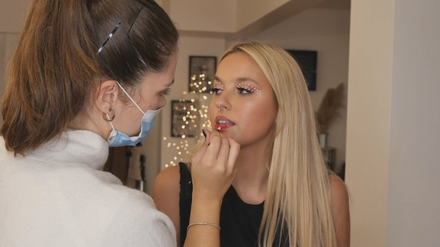 Makeup Artist Applies Red Lipstick thumbnail