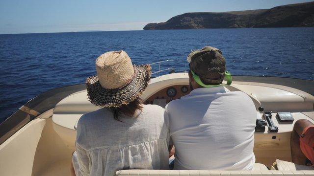 Couple Driving a Boat  thumbnail