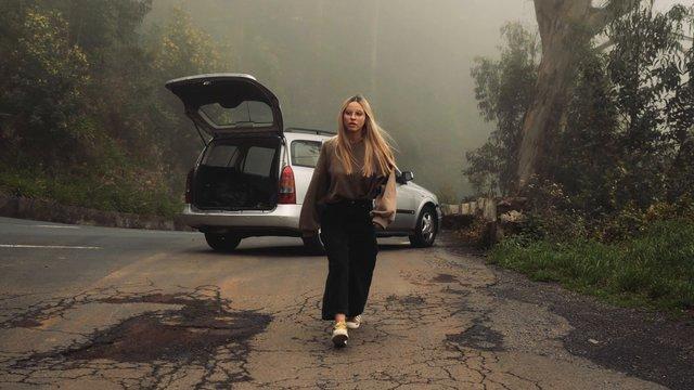 Girl Walking On Misty Road  thumbnail