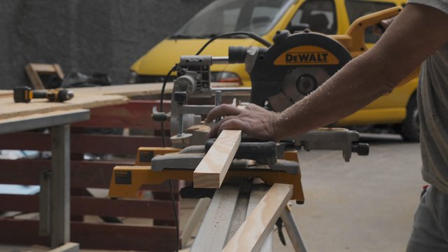 Carpenter Works With a Miter Saw thumbnail
