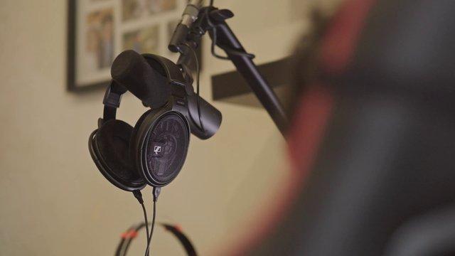 Man Grabs Headphones thumbnail