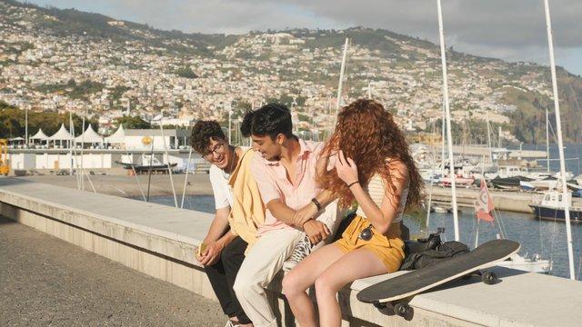 Group of Friends Talking & Hugging thumbnail
