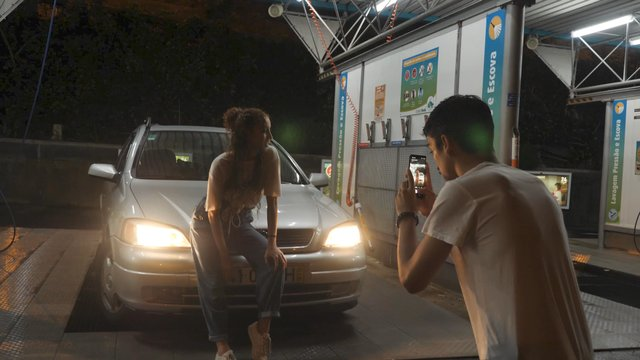 A Guy Takes Pictures of the Girl at the Car Wash thumbnail