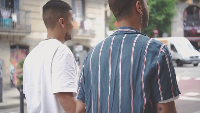 Two Men Embracing And Walking thumbnail