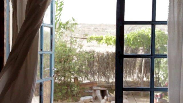 Billowing Curtain and a Backyard thumbnail