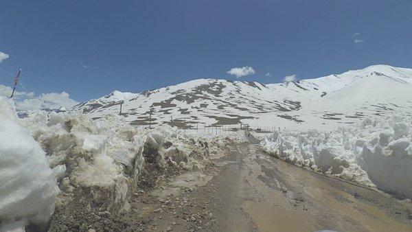 Bike Ride at Snow covered Kunzum Top, Spiti.