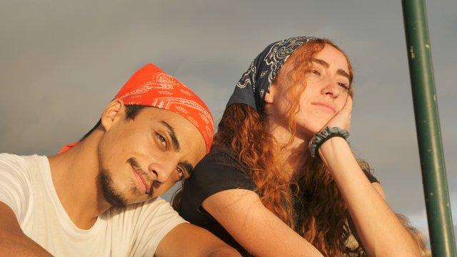 A Couple Relax on the Sunny Beach thumbnail