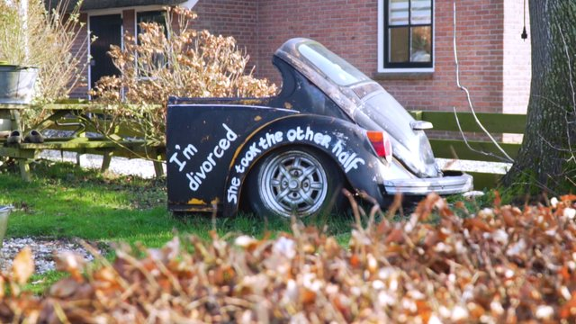 Destroyed Car With A Funny Painted Text thumbnail