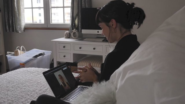 Girl Talks by Video Call Sitting in a Bed  thumbnail