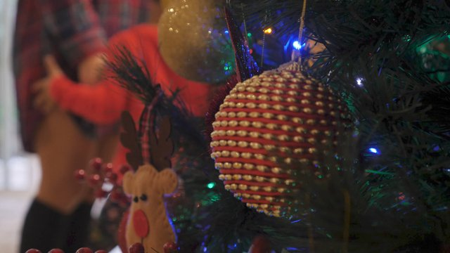 Close up Shot of Colorful Baubles and Ornaments on a Christmas Tree  thumbnail