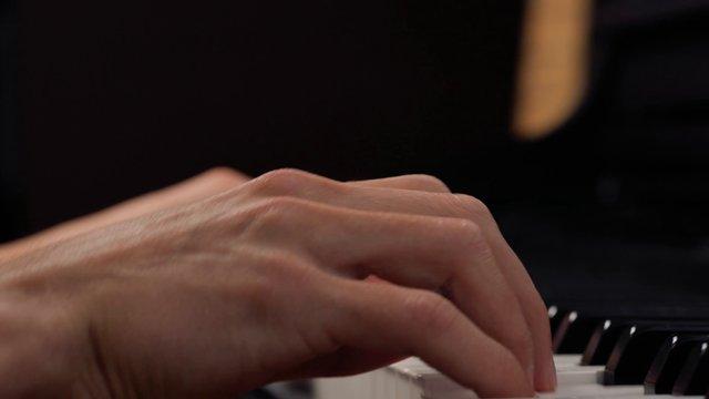 Close-up Hands Playing The Piano thumbnail