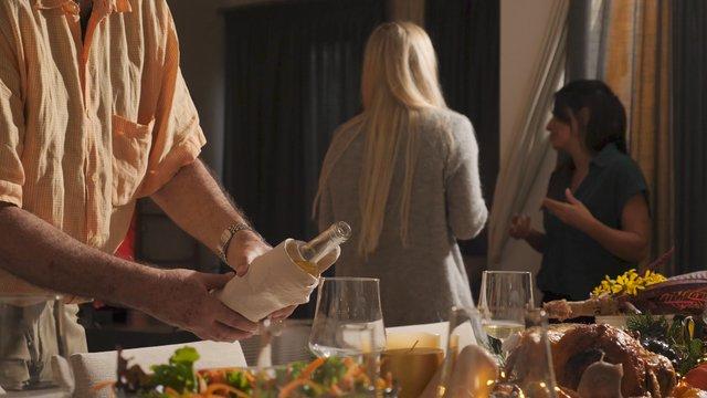 A Man Pours a Glass of Wine thumbnail