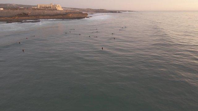 Surfers on Blue Ocean Waves thumbnail