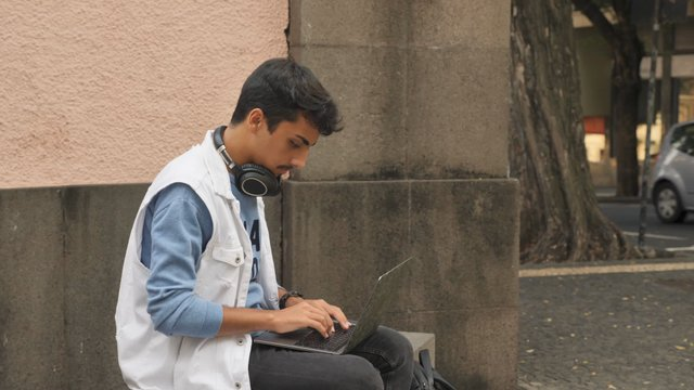 Guy Uses a Laptop on the Street thumbnail