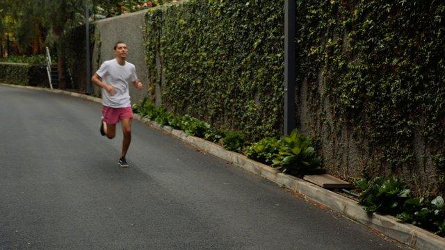 Boy Jogging On Street thumbnail