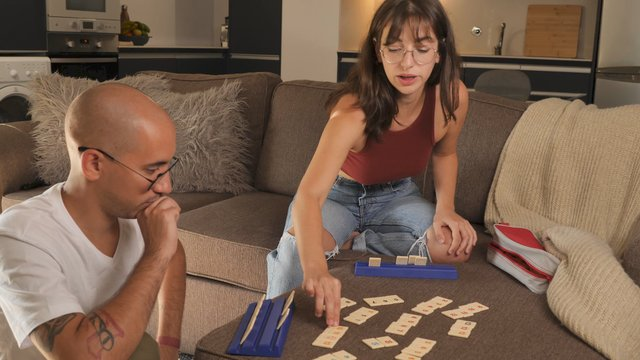 A Couple Plays a Board Game on a Sofa thumbnail